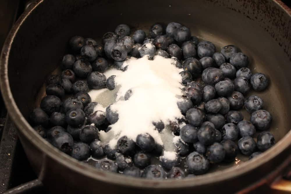 Simmer the berries with a little sugar and lemon juice