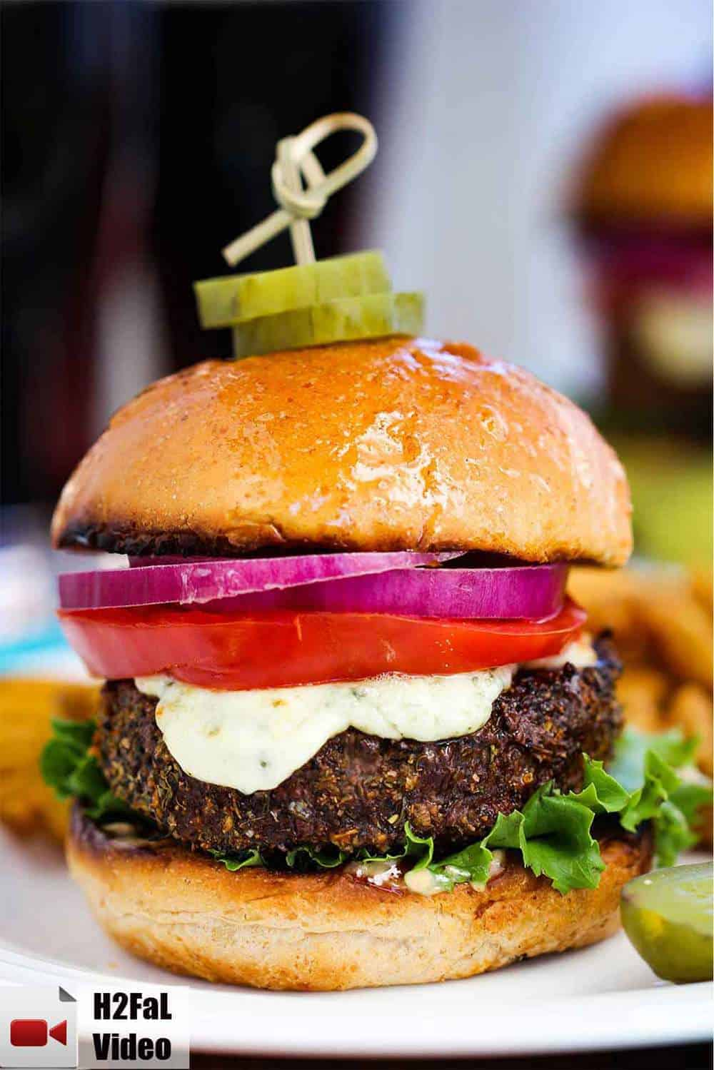 Black and bleu burger on a white plate