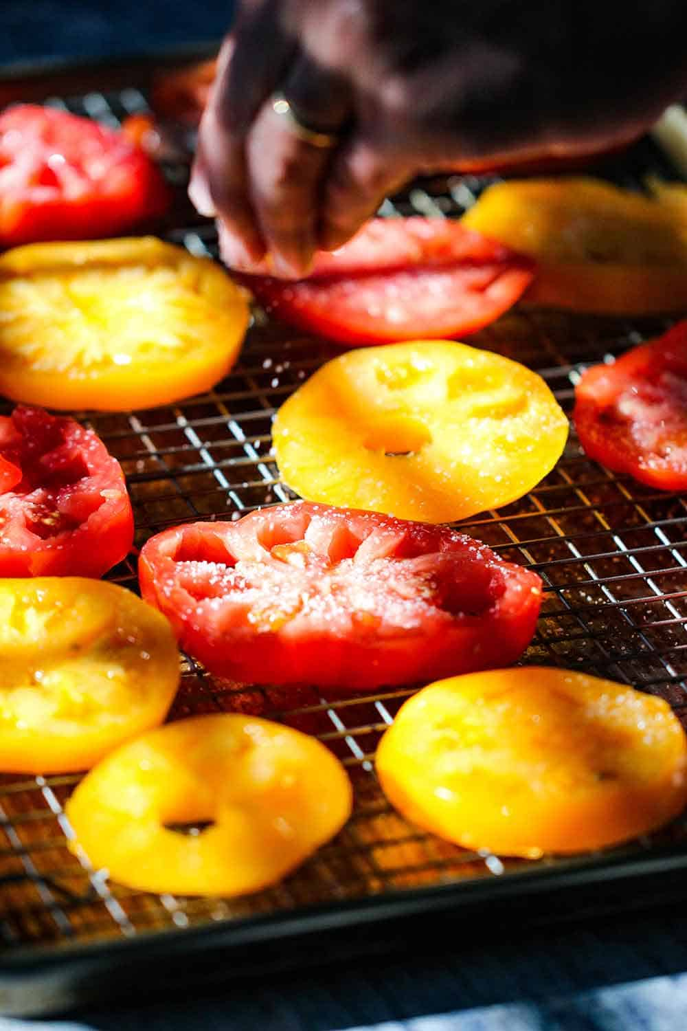 Sprinkle salt on the tomatoes to remove excess water.