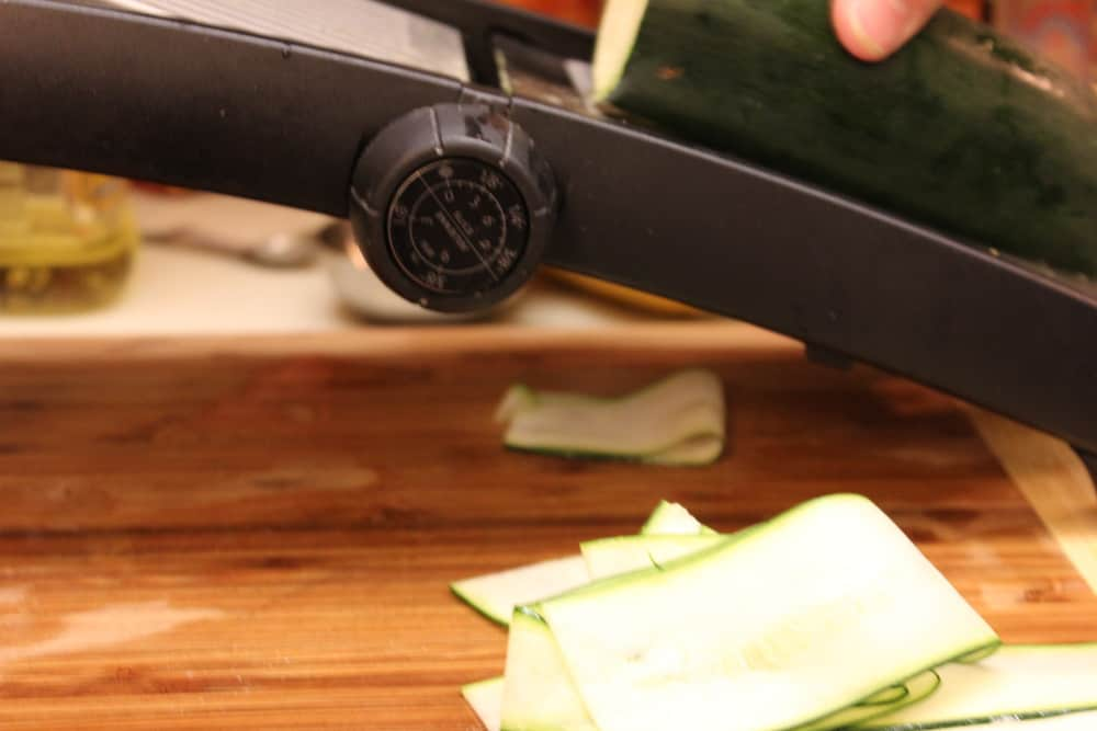A mandolin makes thin ribbons, but a sharp knife works too