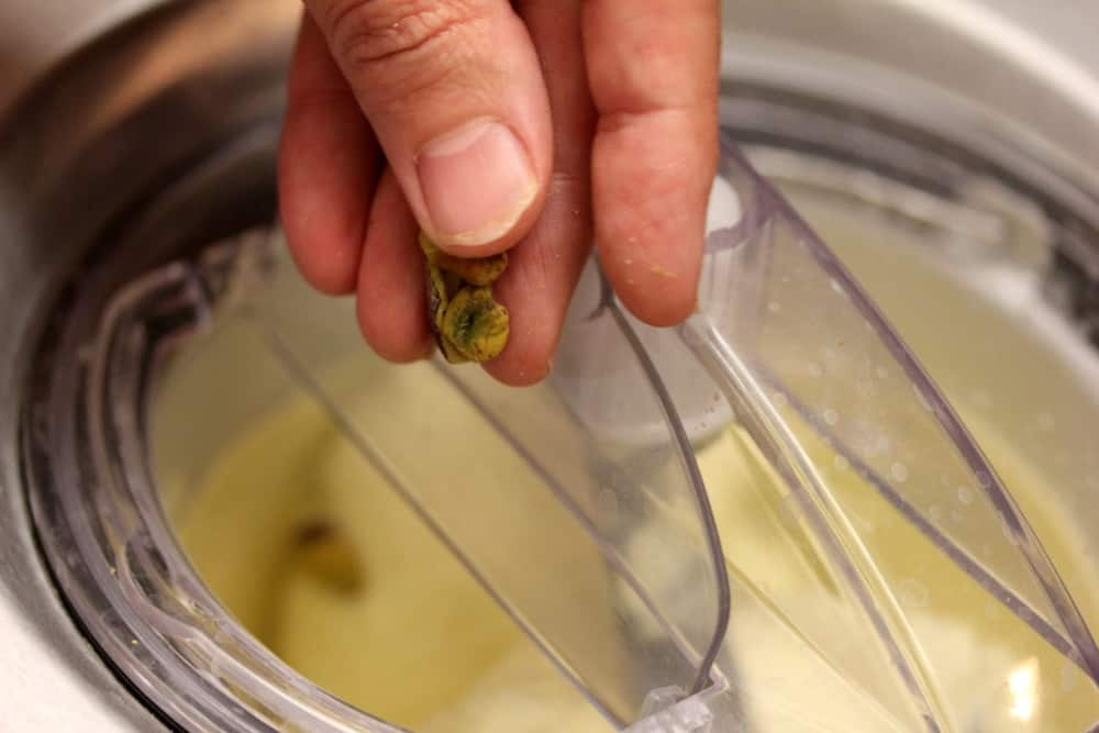 Add the pistachios about 5 minutes before the ice cream is done churning