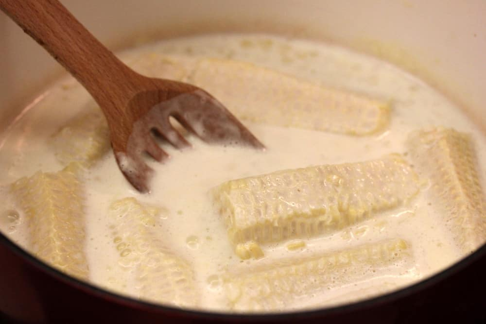 Simmer the cream, sugar and corn!
