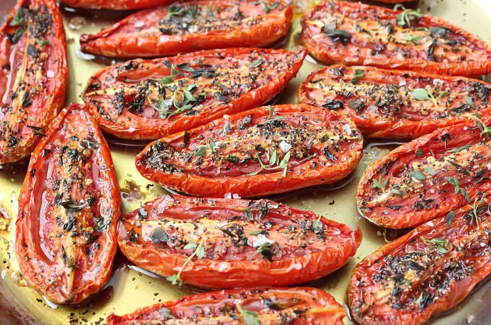 A baking sheet filled with slow-roasted tomatoes.