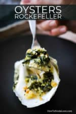 A spoon being held up with a spinach mixture in it from an oysters Rockefeller.