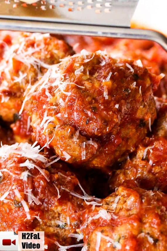 Italian meatballs with Parmesan cheese grated on top.