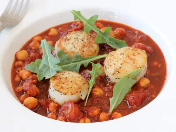 Seared scallops with stewed tomatoes and chickpeas