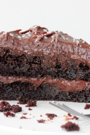 Extreme Chocolate Layer Cake on a white plate with a silver fork