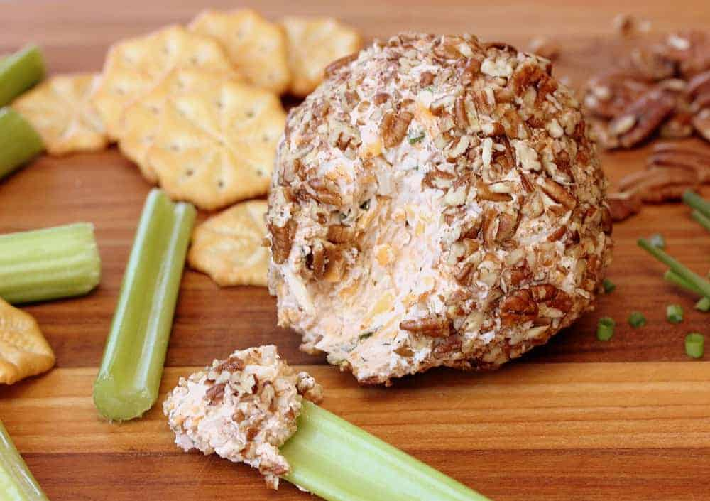 Classic Cheese Ball next to celery sticks and crackers