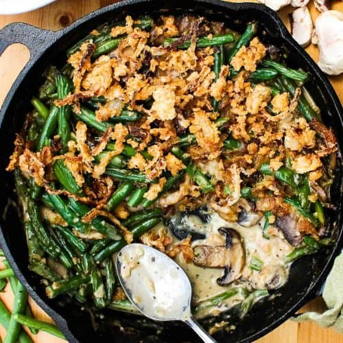 Gourmet green bean casserole in a cast iron skillet
