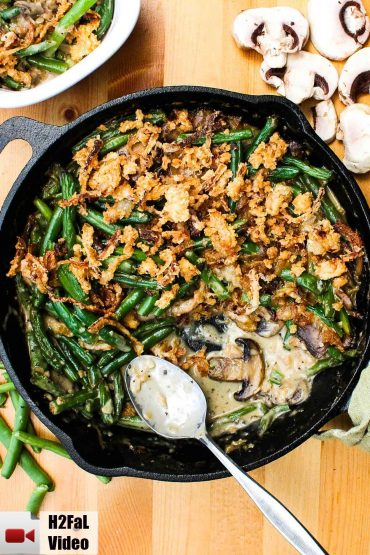 Gourmet green bean casserole in a black cast iron skillet