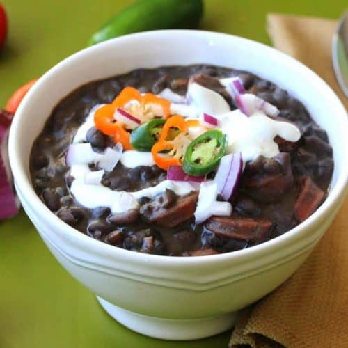 A white bowl of Black Bean with Andouille Sausage Soup