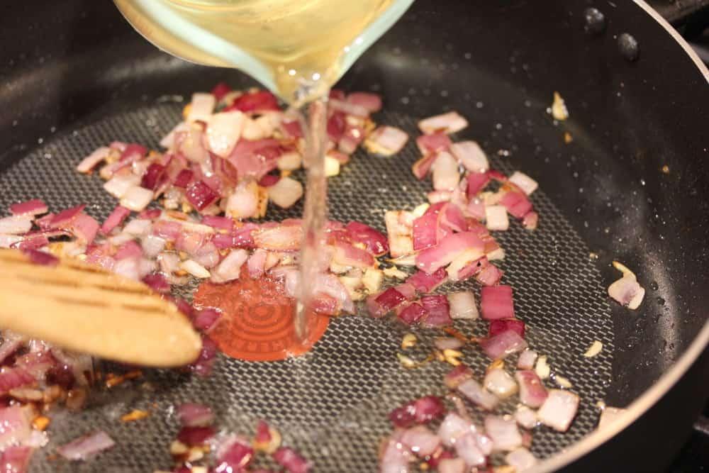Deglaze the pan with white wine