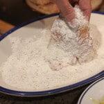Dredge a thin chicken cutlet in seasoned flour