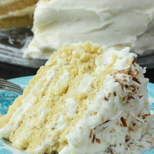 A slice of Coconut Cream Cake on a blue plate