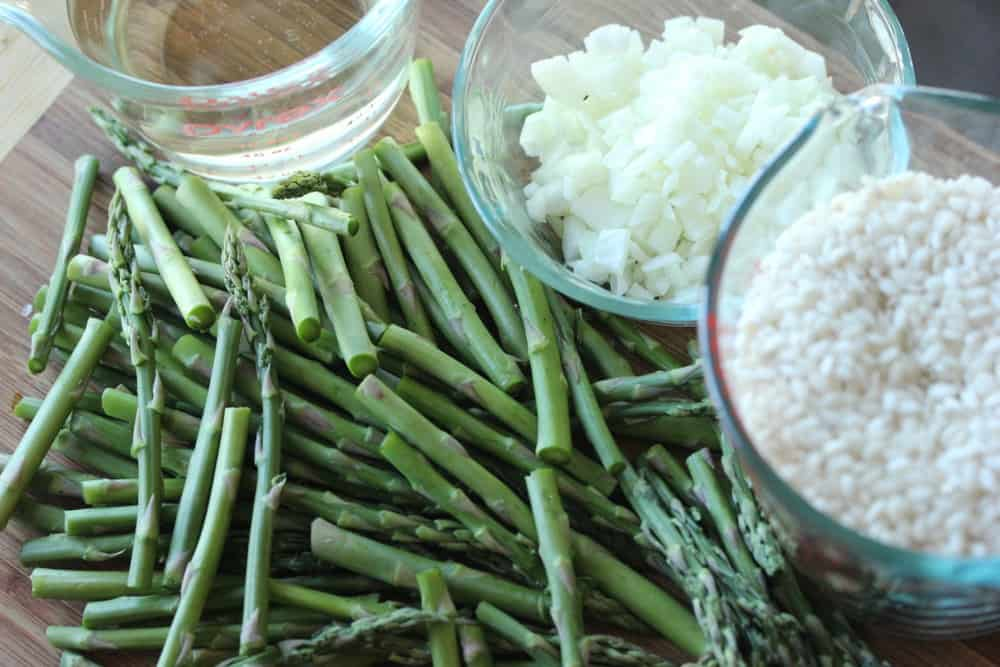 Fresh asparagus, arborio rice, dry wine, and garlic and onions are a good place to start