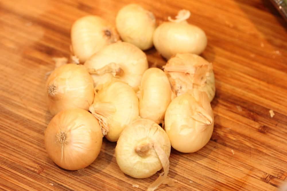 Onions on a wood cutting board