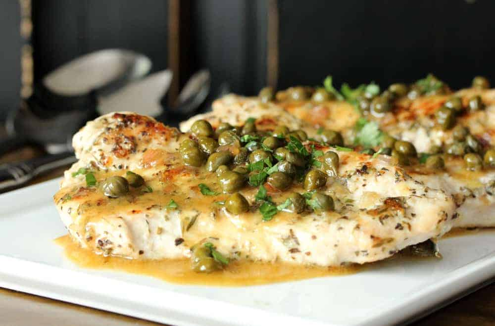 Turkey Cutlets with Honey Mustard-Lime Sauce on a white plate