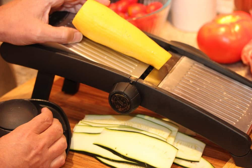 A mandolin ensures thin, evenly slices, but so does a good sharp knife!
