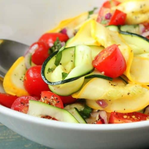 Zucchini and Summer Squash Salad in a white bowl.
