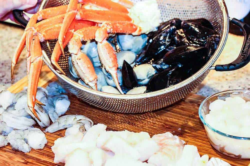 Crab, mussels and other seafood on a cutting board for cioppino