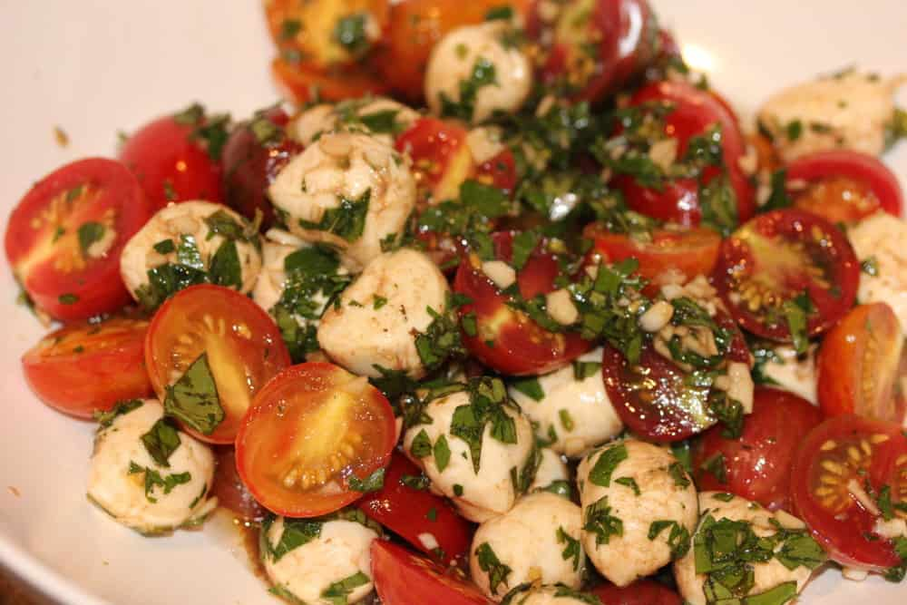Tomatoes and mozzarella in marinade