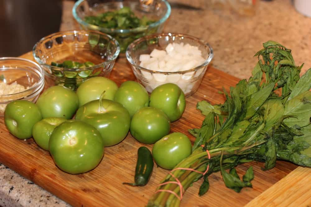 Next you'll need serano chilis, tomatillos, white onion and epazote (on the right)