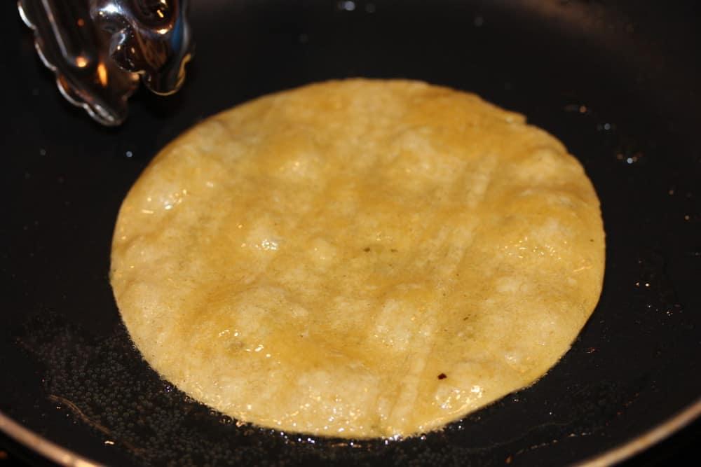 Lightly fry a corn tortilla in a little oil
