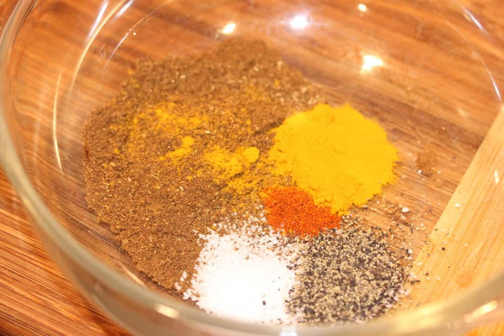 Mix together the toasted ground seeds and spices