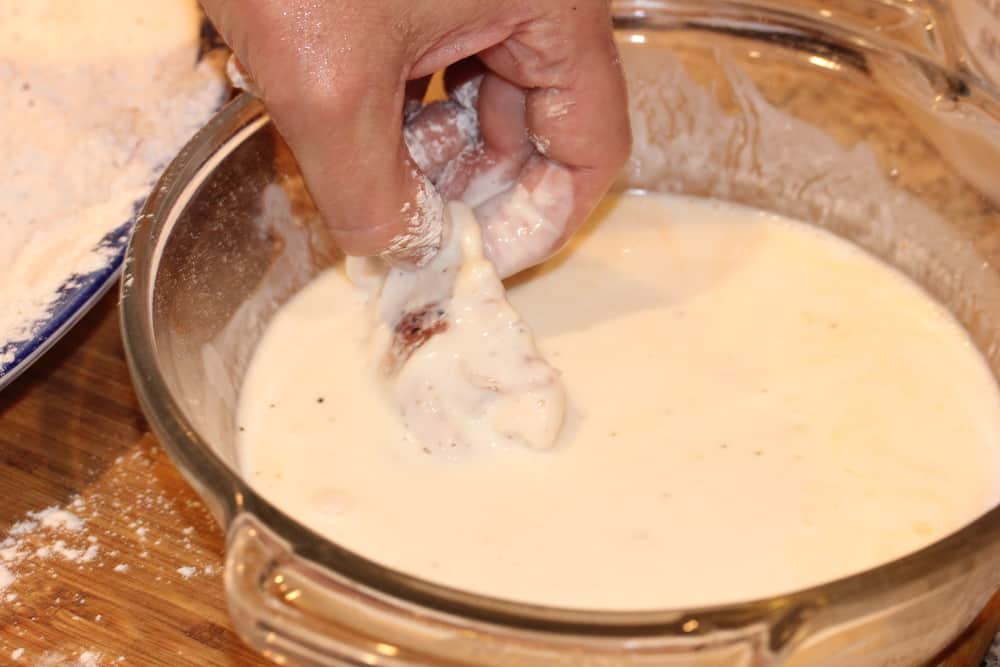Dip the seasoned chicken pieces into the buttermilk mixture