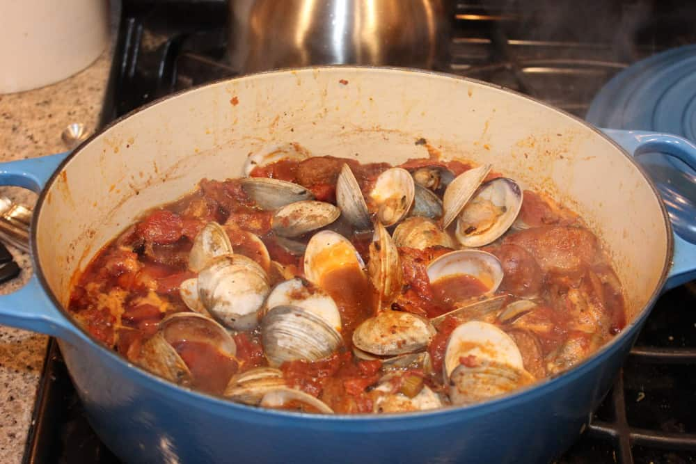 Simmer until the clams open, about 8 minutes
