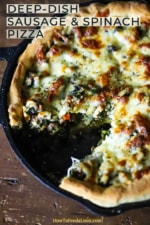 A cast-iron skillet filled with a deep-dish sausage and spinach pizza with a slice missing.