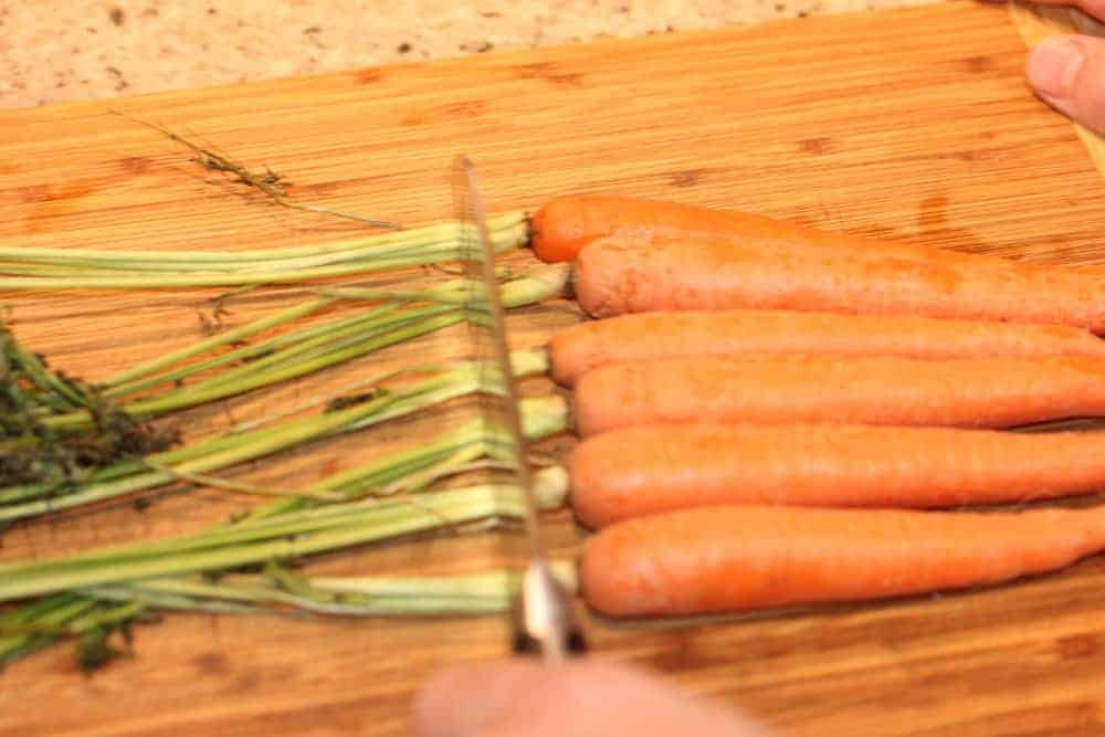 Start by trimming the carrot tops