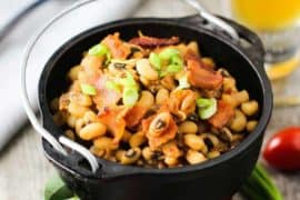Black-eyed peas with tomatoes in a black crock