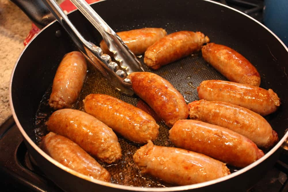 Start off by searing the sausages