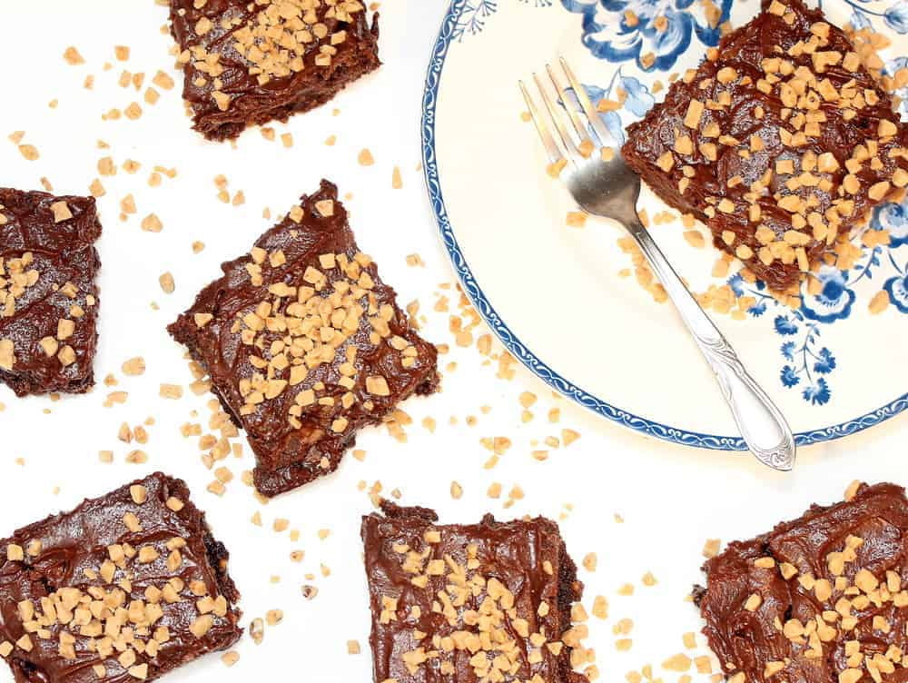 Heath Bar Fudge Brownies on a blue and white plate with a silver fork