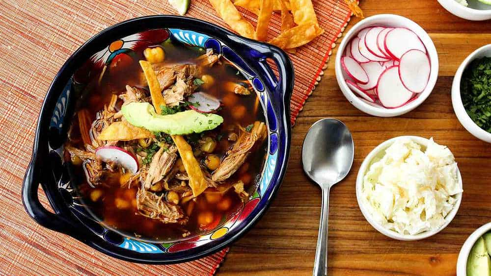 A bowl of Pozole. Rojas (Pork and Hominy Stew)