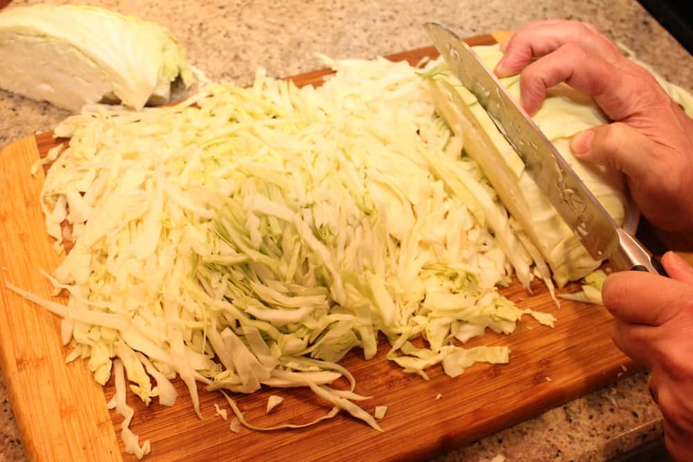 Core the cabbage and then slice it thinly