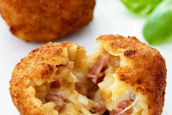 Split the arancini open and see the melted cheese and prosciutto