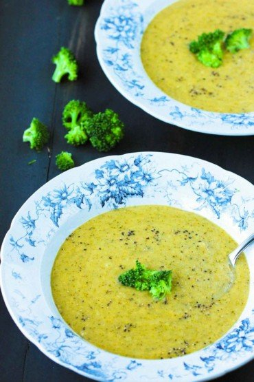 Two patterned bowls with Broccoli Cheddar Soup