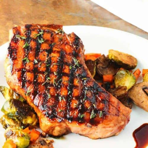 Balsamic Grilled Pork Chops on a white plate