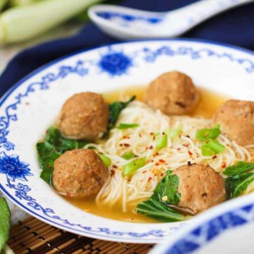 Asian Fusion Wedding Soup in a patterned bowl next to a dark napkin