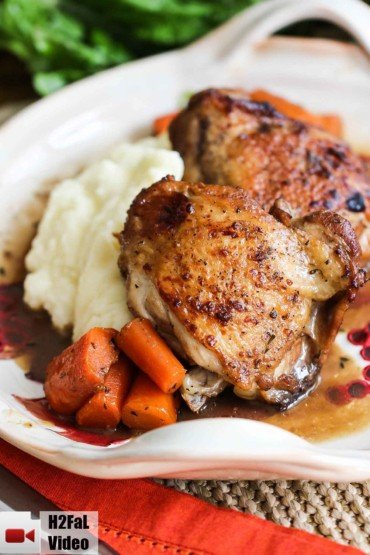 A plate of honey balsamic chicken with potatoes and carrots