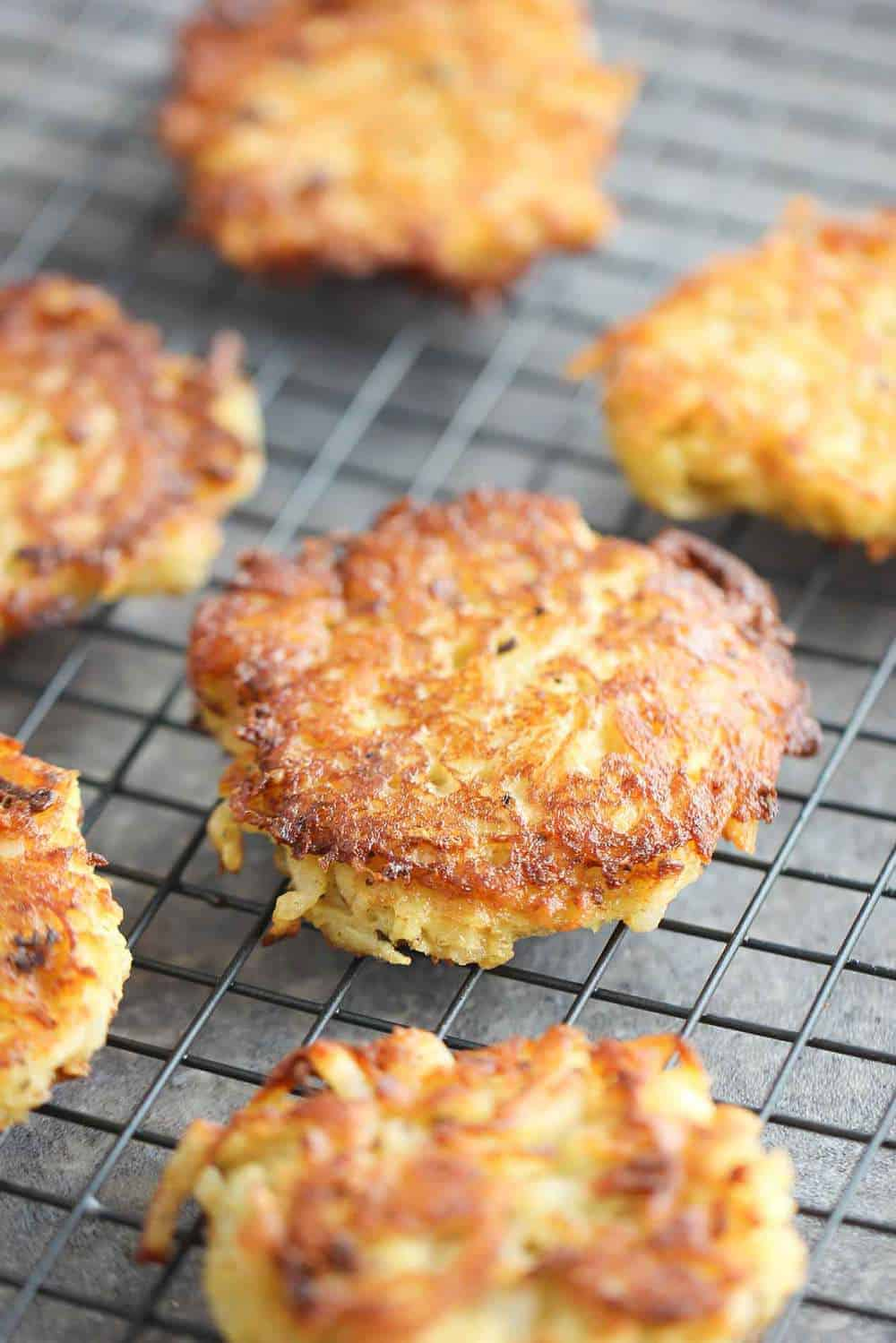 Latkes on a black wire cooling rack