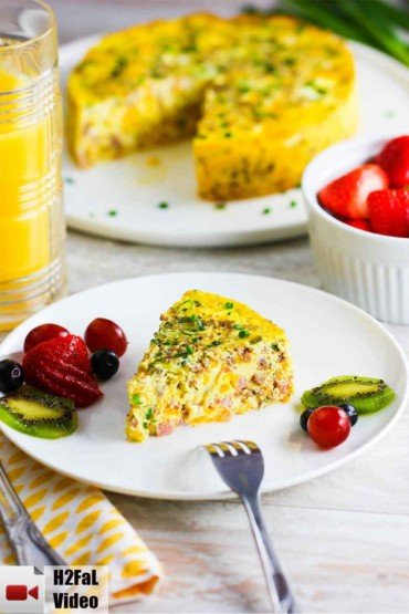 A slice of Instant Pot Cheesy Frittata on a white plate