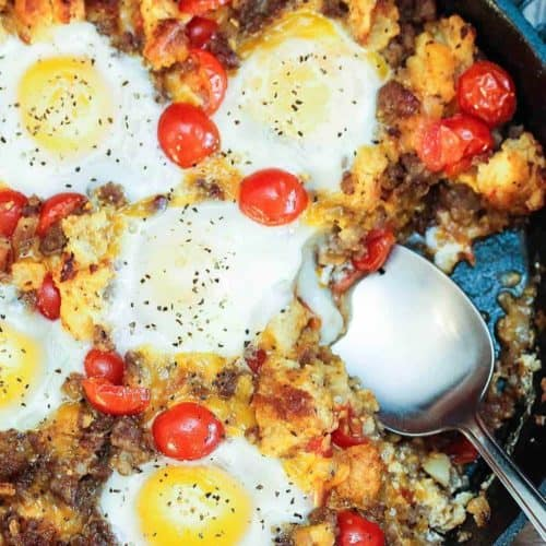 A skillet with best-ever skillet breakfast and a spoon