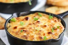 this is a baked jumbo crab au gratin in mini cast iron skillets