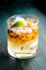 A Dark 'n stormy cocktail in a rocks glass with chipped ice