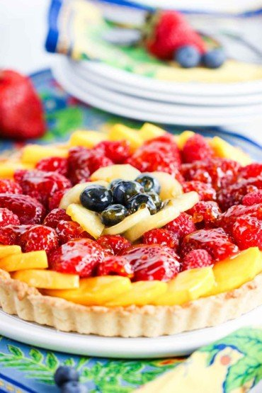 the fruit is layered beautifully in this classic fruit tart