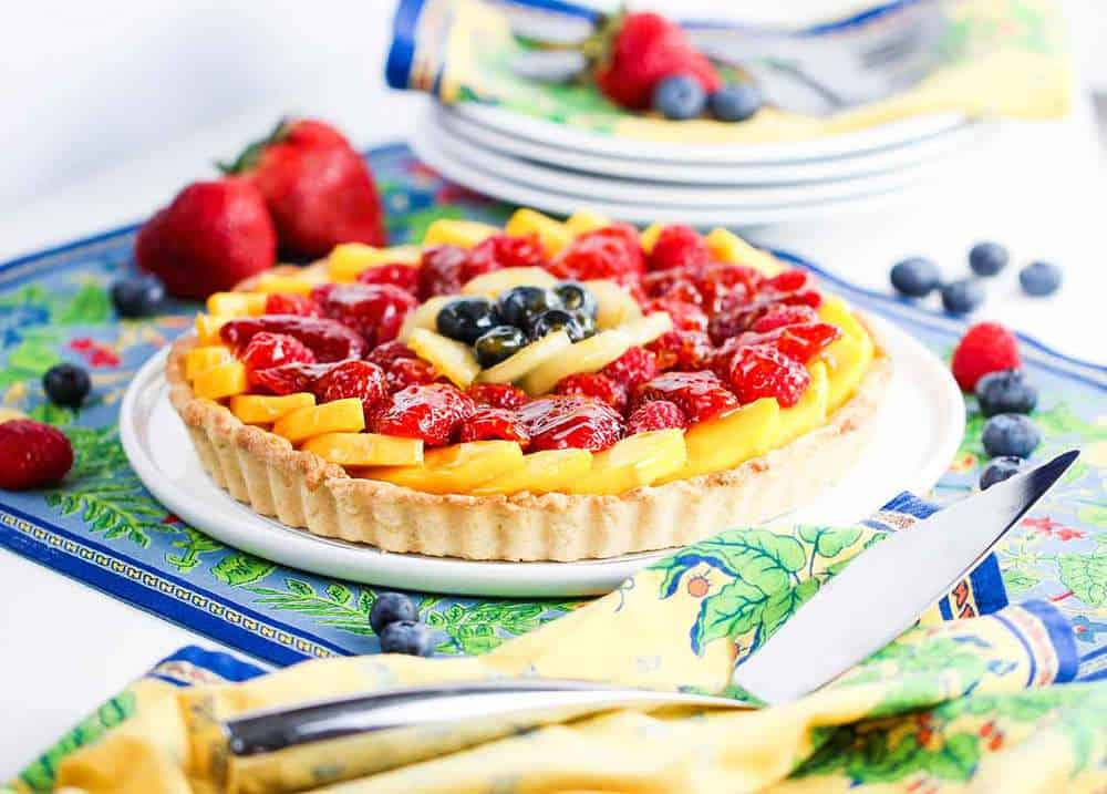 classic fruit tart on floral place mat