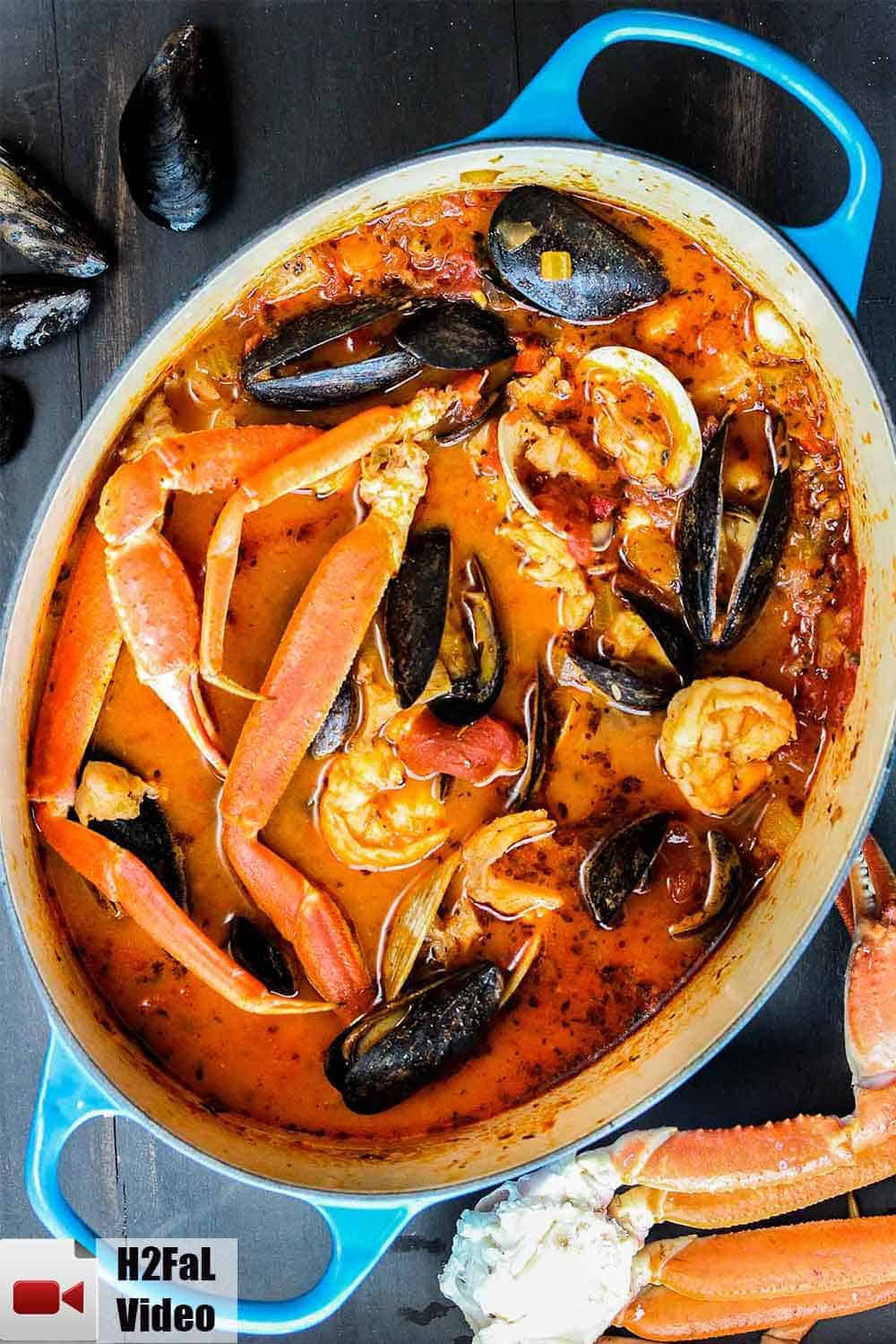 Classic cioppino in a large blue Dutch oven.